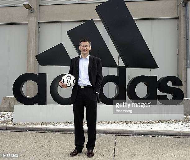 Herbert Hainer AdidasSalomon AG chief executive officer poses in front the Adidas logo before their annual press conference in Herzogenaurach Germany...
