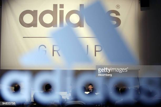 Herbert Hainer bottom center AdidasSalomon AG chief executive officer speaks at their annual press conference in Herzogenaurach Germany Thursday...