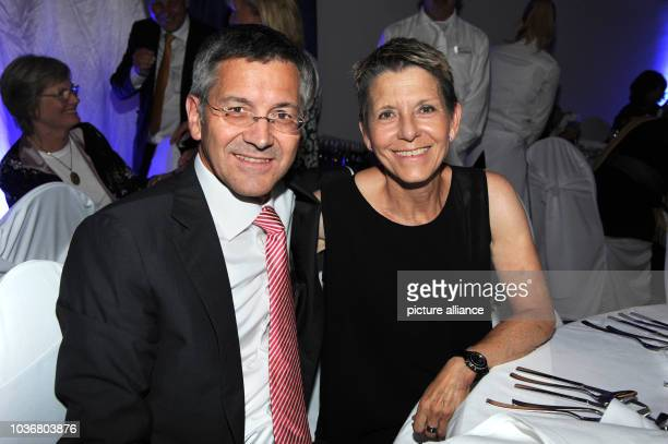 Herbert Hainer CEO of Adidas AG and his wife Angelika enjoying the gala that is being held as part of the 29th Kaiser Cup golf tournament The event...