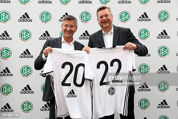 Herbert Hainer CEO of adidas group poses with Reinhard Grindel president of Deutscher Fussball Bund DFB during a DFB and adidas press conference at...