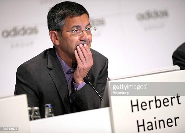 Herbert Hainer chief executive officer of Adidas AG gestures during the presentation of the company's 2008 results at a news conference in...