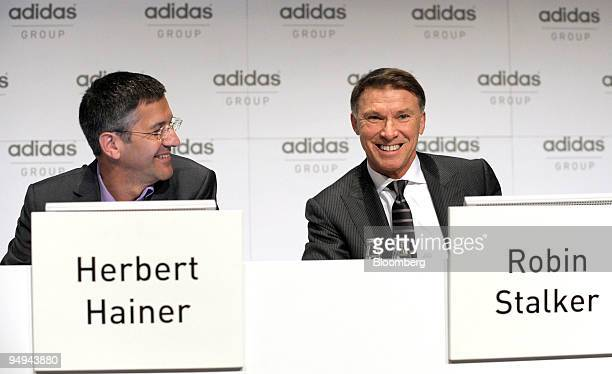 Herbert Hainer chief executive officer of Adidas AG left speaks as Robin Stalker chief financial officer of Adidas AG looks on prior to the...