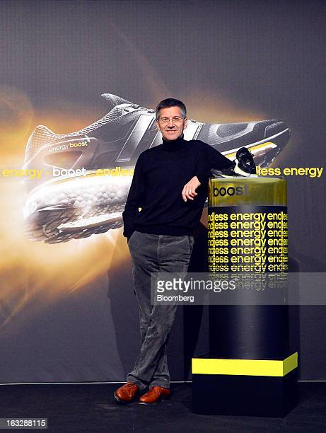Herbert Hainer chief executive officer of Adidas AG poses for photographers ahead of the company's earnings news conference in Herzogenaurach Germany...