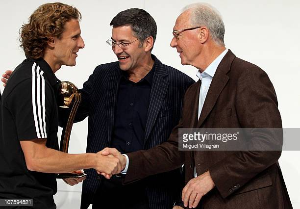 Herbert Hainer the adidas Group CEO and FIFA executive committee member Franz Beckenbauer hand over the adidas Golden Ball award to Diego Forlan...