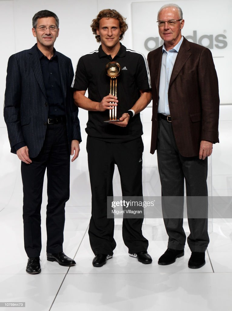 Herbert Hainer, the adidas Group CEO, Diego Forlan, adidas Golden Ball Winner and FIFA executive committee member Franz Beckenbauer pose during the FIFA 2010 World Cup adidas Golden Award ceremony at the adidas headquarters on December 14, 2010 in Herzogenaurach, Germany.