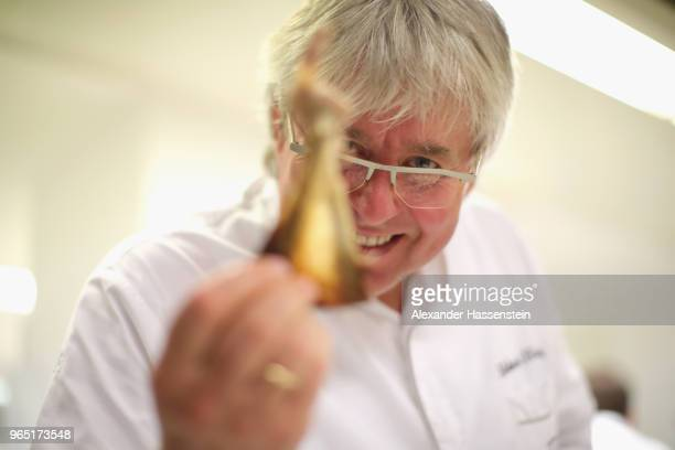 "Herbert Hintner, chef at ""Zur Rose"" restaurant, prepares lamb shoulder in the restaurant kitchen on May 31, 2018 in Eppan, Italy. ""Zur Rose,"" located..."
