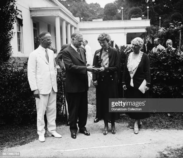 Herbert Hoover presenting the National Geographic Society medal to Amelia Earhart with Dr Gilbert Grosvenor at left White House Washington DC