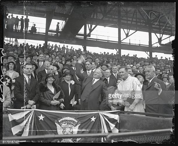 Herbert Hoover throwing out the 1st ball opening the 1931 baseball season Game was between the Washington Senators and the Philadelphia A's Man in...