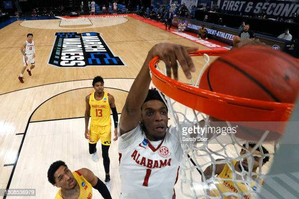 Herbert Jones of the Alabama Crimson Tide dunks in the first half against the Maryland Terrapins in the second round game of the 2021 NCAA Men's...
