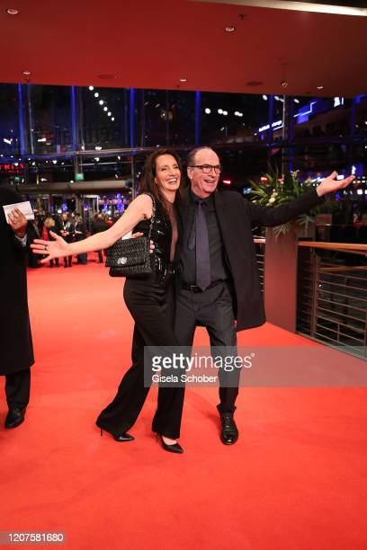 Herbert Knaup and his wife Christiane arrive for the opening ceremony and My Salinger Year premiere during the 70th Berlinale International Film...