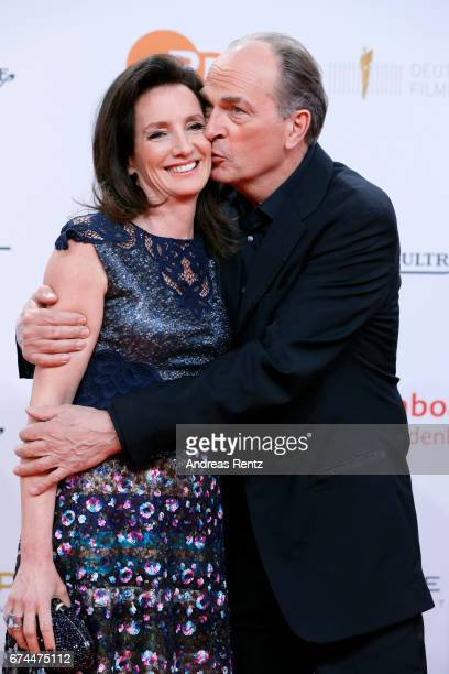 Herbert Knaup kisses his wife Christiane on the cheek during the Lola German Film Award red carpet at Messe Berlin on April 28 2017 in Berlin Germany