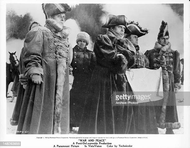 Herbert Lom as Napoleon and other officers gather in the snow in a scene from the film 'War And Peace' 1955