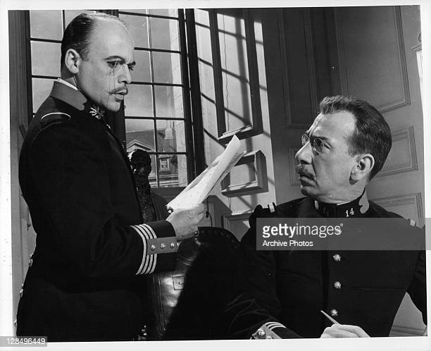 Herbert Lom asks Jose Ferrer to write a message in a scene from the film 'I Accuse' 1958