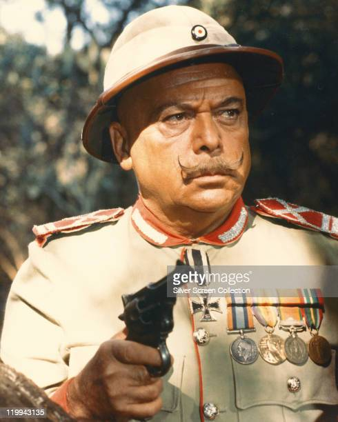 Herbert Lom Czech actor wearing German military uniform while holding a handgun in a publicity still issued for the film 'King Solomon's Mines' 1985...