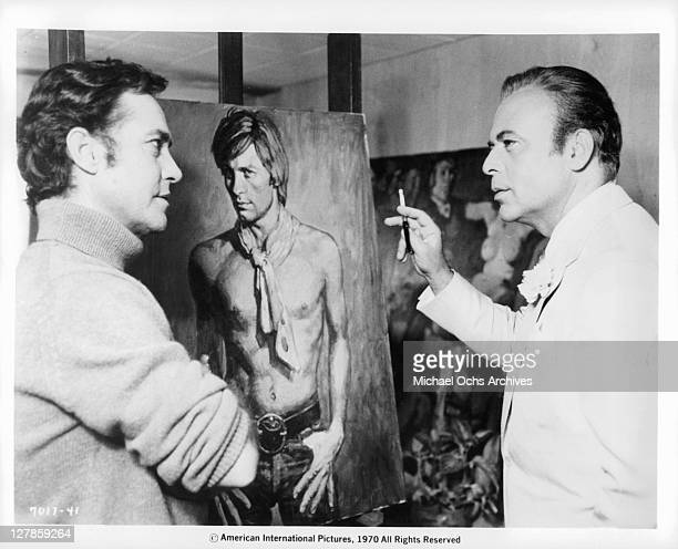 Herbert Lom discusses the portrait of Dorian Gray with the artist Richard Todd in a scene from the film 'Dorian Gray' 1970