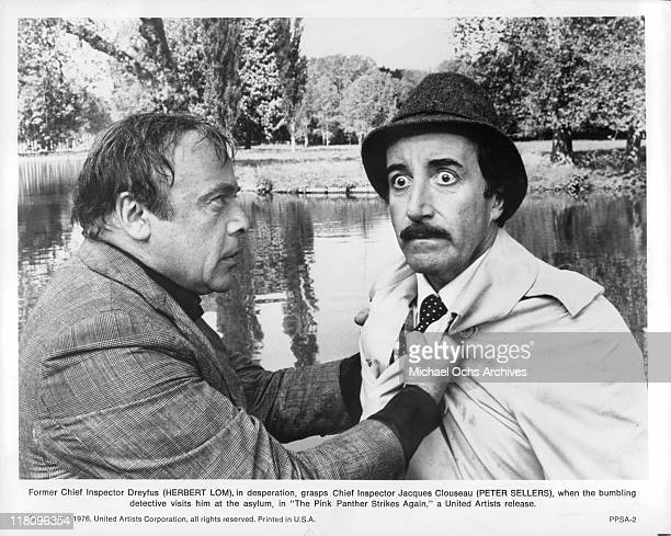 Herbert Lom grasps Peter Sellers as Inspector Clouseau in a scene from the film 'The Pink Panther Strikes Again' 1976