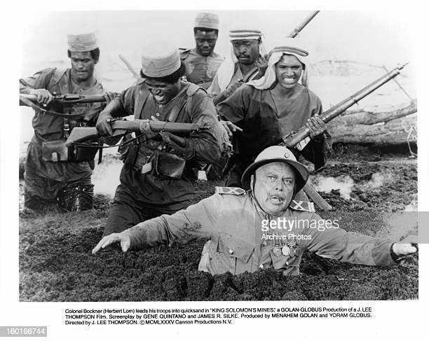 Herbert Lom leads his troops through quicksand in a scene from the film 'King Solomon's Mines' 1985