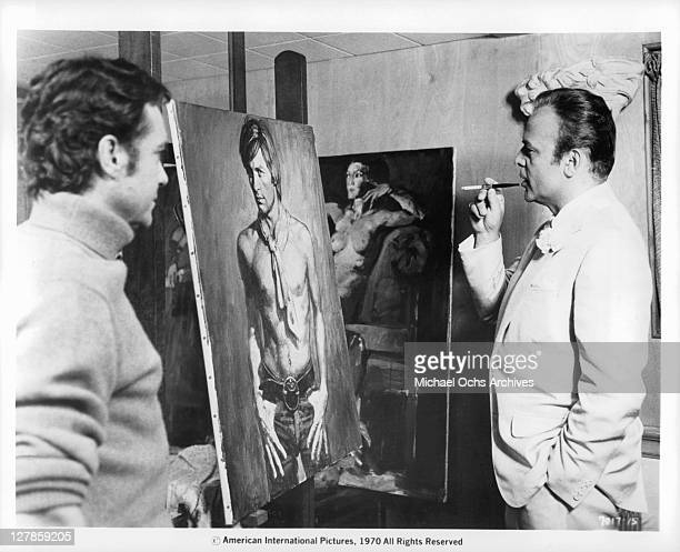 Herbert Lom observes with keen interest Dorian Gray's portrait as the artist Richard Todd stands by in a scene from the film 'Dorian Gray' 1970