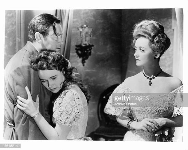 Herbert Marshall holds Teresa Wright while Bette Davis looks at him in a scene from the film 'The Little Foxes' 1941