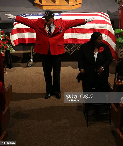 Herbert Otey from Tuskagee Airmen Inc asks people to sit as the funeral for retired Air Force Lt Col Eldridge Williams starts at the Sweet Home...