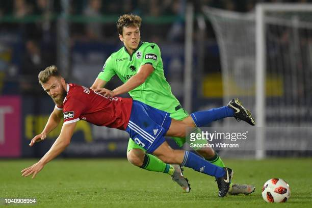 Herbert Paul of 1860 Muenchen and Stephan Hain of Unterhaching compete for the ball during the 3. Liga match between SpVgg Unterhaching and TSV 1860...