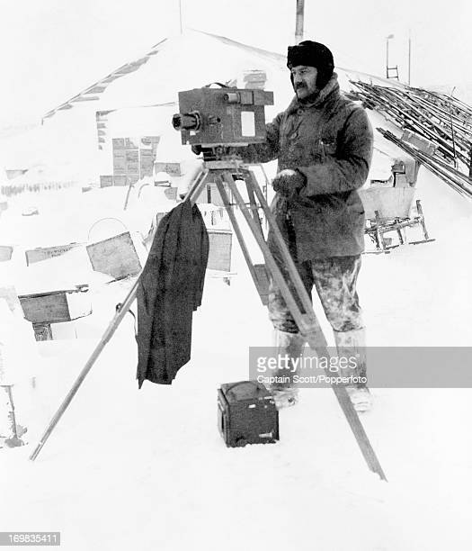 Herbert Ponting at work at Cape Evans photographed during the last tragic voyage to Antarctica by Captain Robert Falcon Scott circa October 1911...