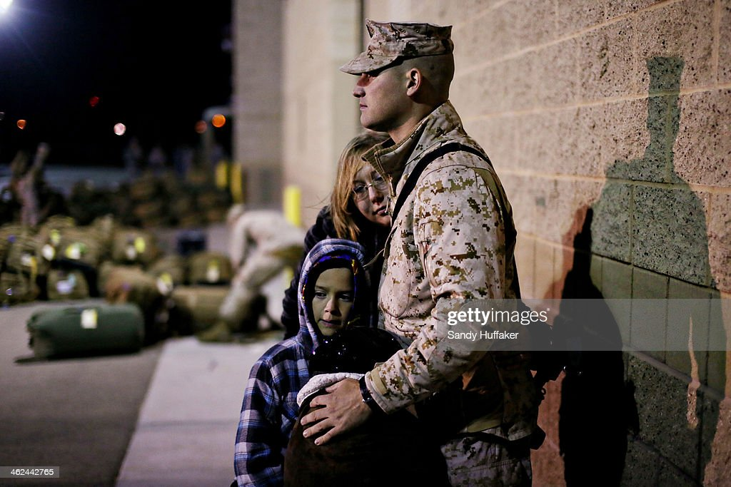 Herbert Robertson shares a moment with his wife Janet and son Oliver, 7, and daughter Jovi, 5, before deploying to Afghanistan on January 13, 2014 at Camp Pendleton, California. Approximately 140 of the I MEF command element's 300 Marines and sailors are making a final year long deployment to the Helmand province area of Afghanistan in support of Operation Enduring Freedom. The Marines will join approximately 9000 coalition troops currently in the region and help support Afghan National Security Forces.