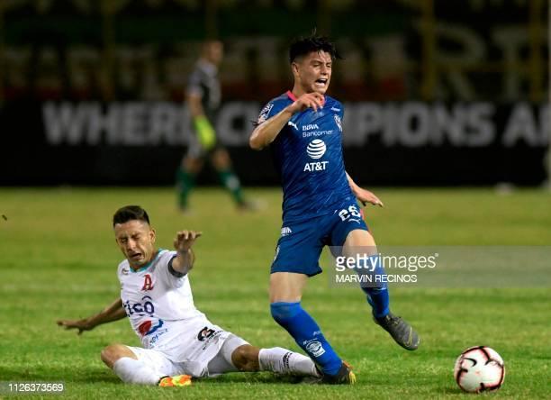 Herbert Sosa of El Salvador's Alianza vies for the ball with Jonathan Gonzalez of Rayados de Monterrey of Mexico during their CONCACAF Champions...
