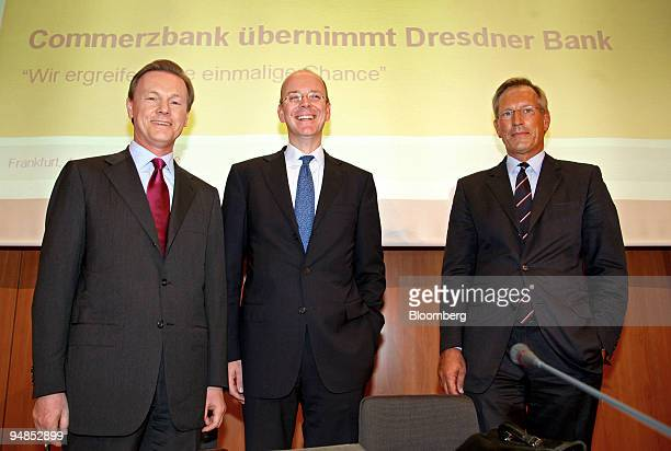 Herbert Walter chief executive officer of Dresdner Bank left stands with Martin Blessing chief executive officer of Commerzbank center and Michael...