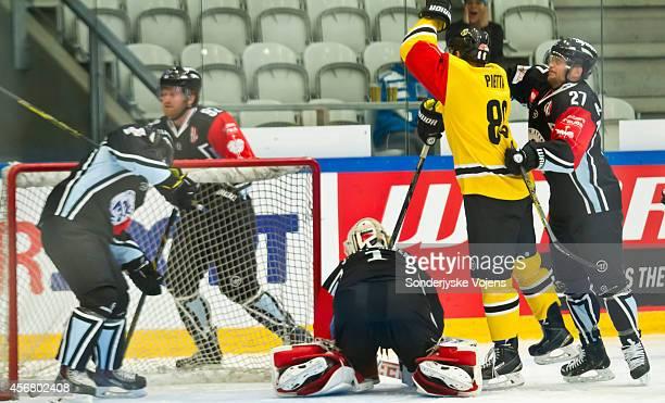 Herberts Vasiljevs of Krefeld Pinguine scores during the Champions Hockey League group stage game between Sonderjyske Vojens and Krefeld Pinguine on...