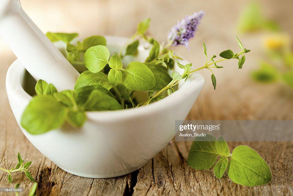Herbes de Provence in a white mortar : Stock Photo