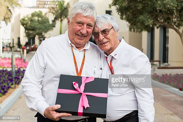 Herbie Blash of the FIA and Great Britain receives a gift from Bernie Ecclestone of the FIA and Great Britain at his last F1 Grand Prix during...