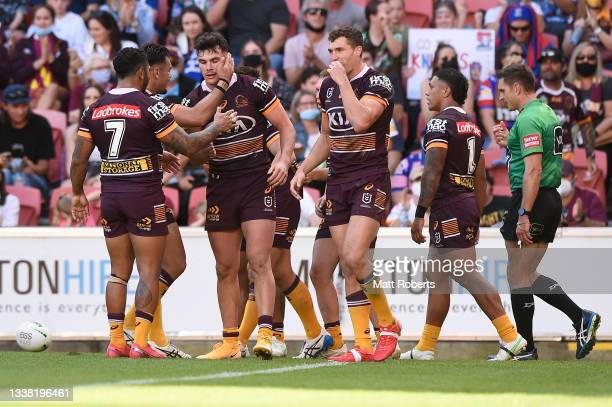 Herbie Farnworth of the Broncos celebrates scoring a try with team mates during the round 25 NRL match between the Brisbane Broncos and the Newcastle...