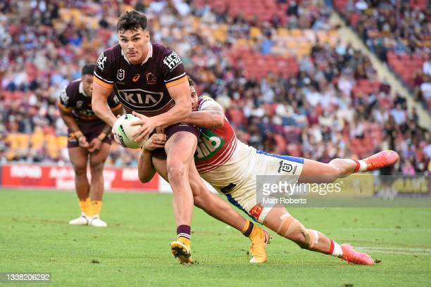 Herbie Farnworth of the Broncos is tackled during the round 25 NRL match between the Brisbane Broncos and the Newcastle Knights at Suncorp Stadium,...