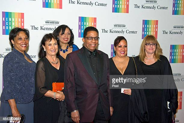 Herbie Hancock and his wife Gigi Hancock and family arrive at the formal Artist's Dinner honoring the recipients of the 2013 Kennedy Center Honors...