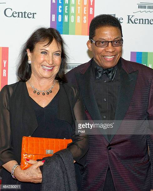 Herbie Hancock and his wife Gigi Hancock arrive at the formal Artist's Dinner honoring the recipients of the 2013 Kennedy Center Honors hosted by...