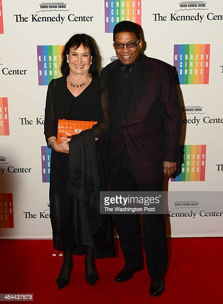 Herbie Hancock and wife Gigi arrive at a special dinner for Kennedy Center honorees and guests at the State Department in Washington DC on December 7...