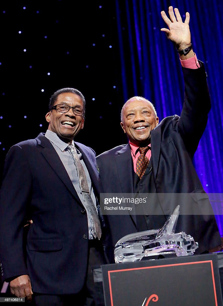 Herbie Hancock (L) present the Herbie Hancock Humanitarian Award to Quincy Jones during the Thelonious Monk Institute International Jazz Vocals Competition 2015 at Dolby Theatre on November 15, 2015 in Hollywood, California.