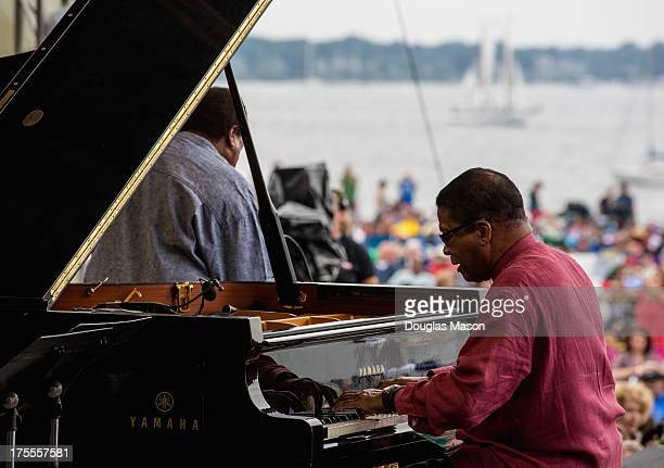 Herbie Hancock sits in with the Wayne Shorter quartet during their performance at the Newport Jazz Festival 2013 at Fort Adams State Park on August 3...