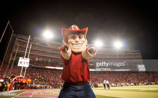 Herbie Husker celebrates a Nebraska Cornhuskers touchdown against the Michigan Wolverines during their game at Memorial Stadium on October 27 2012 in...