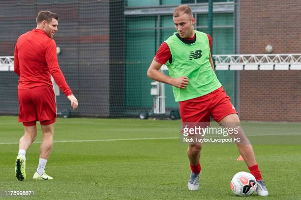 Herbie Kane and James Milner of Liverpool during a training session at Melwood Training Ground on October 15 2019 in Liverpool England