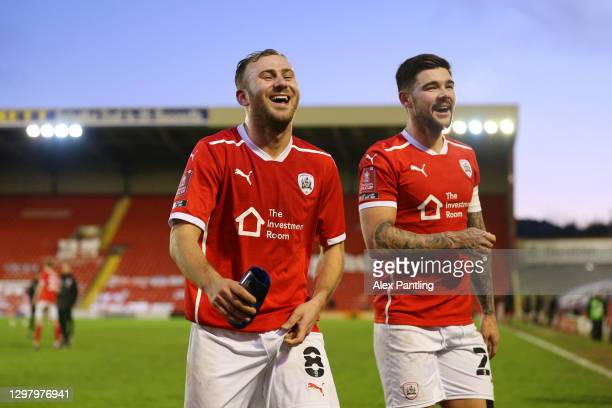 Herbie Kane of Barnsley and Alex Mowatt of Barnsley celebrate following their team's victory in The Emirates FA Cup Fourth Round match between...