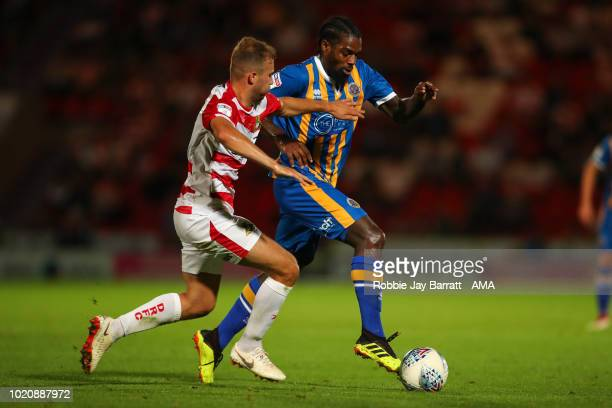 Herbie Kane of Doncaster Rovers and Anthony Grant of Shrewsbury Town during the Sky Bet League One match between Doncaster Rovers and Shrewsbury Town...