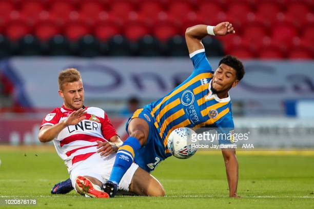 Herbie Kane of Doncaster Rovers and Josh Laurent of Shrewsbury Town during the Sky Bet League One match between Doncaster Rovers and Shrewsbury Town...