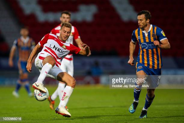 Herbie Kane of Doncaster Rovers and Shaun Whalley of Shrewsbury Town during the Sky Bet League One match between Doncaster Rovers and Shrewsbury Town...
