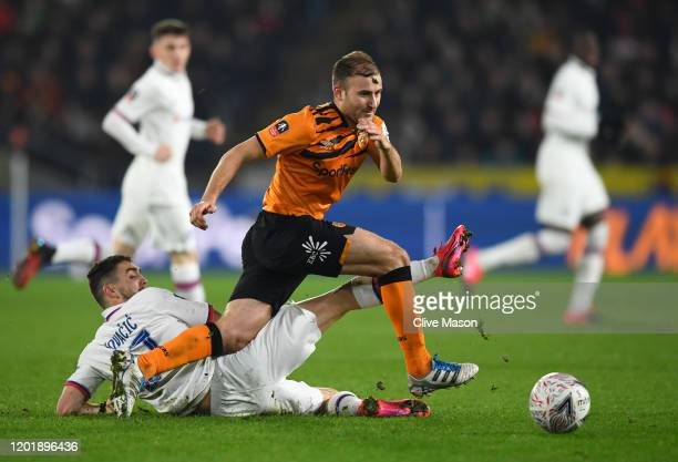 Herbie Kane of Hull City is challenged by Mateo Kovacic of Chelsea during the FA Cup Fourth Round match between Hull City FC and Chelsea FC at KCOM...