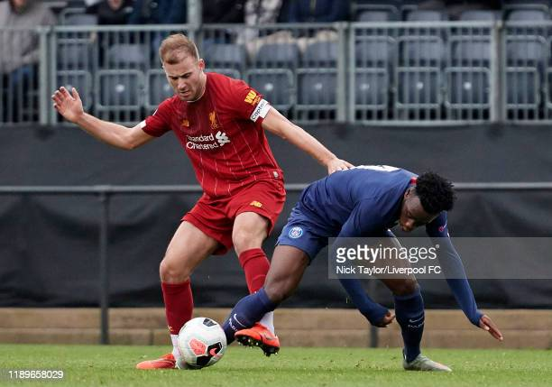 Herbie Kane of Liverpool and Arnaud Kalimuendo of Paris Saint Germain in action during the Premier League International Cup game at the Kirkby...