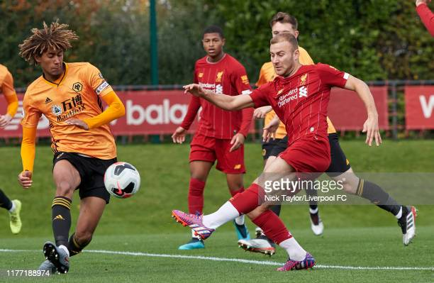 Herbie Kane of Liverpool and Dion Sanderson of Wolverhampton Wanderers in action during the PL2 game at The Kirkby Academy on October 20 2019 in...