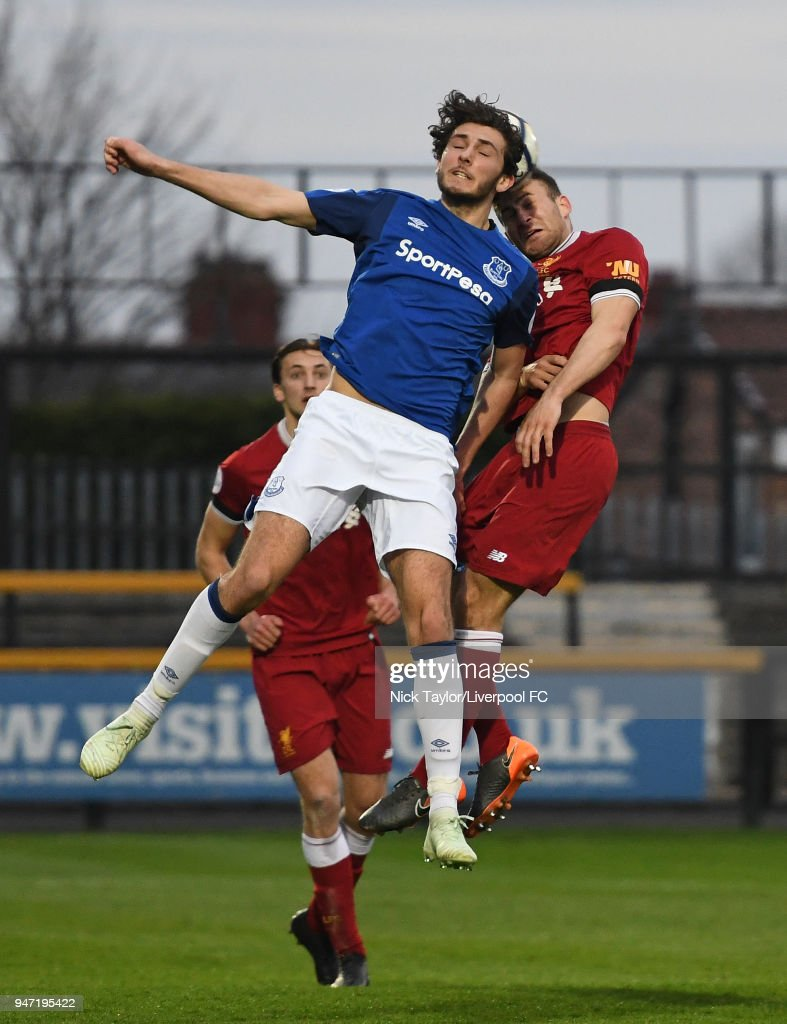 Herbie Kane of Liverpool and Fraser Hornby of Everton in action during the Everton v Liverpool PL2 game on April 16, 2018 in Southport, England.