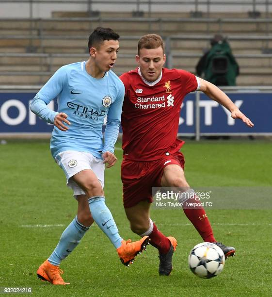 Herbie Kane of Liverpool and Ian Carlo Poveda of Manchester City in action during the Manchester City v Liverpool UEFA Youth League game at...
